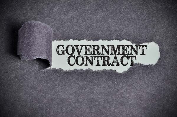 government contract word under torn black sugar paper.
